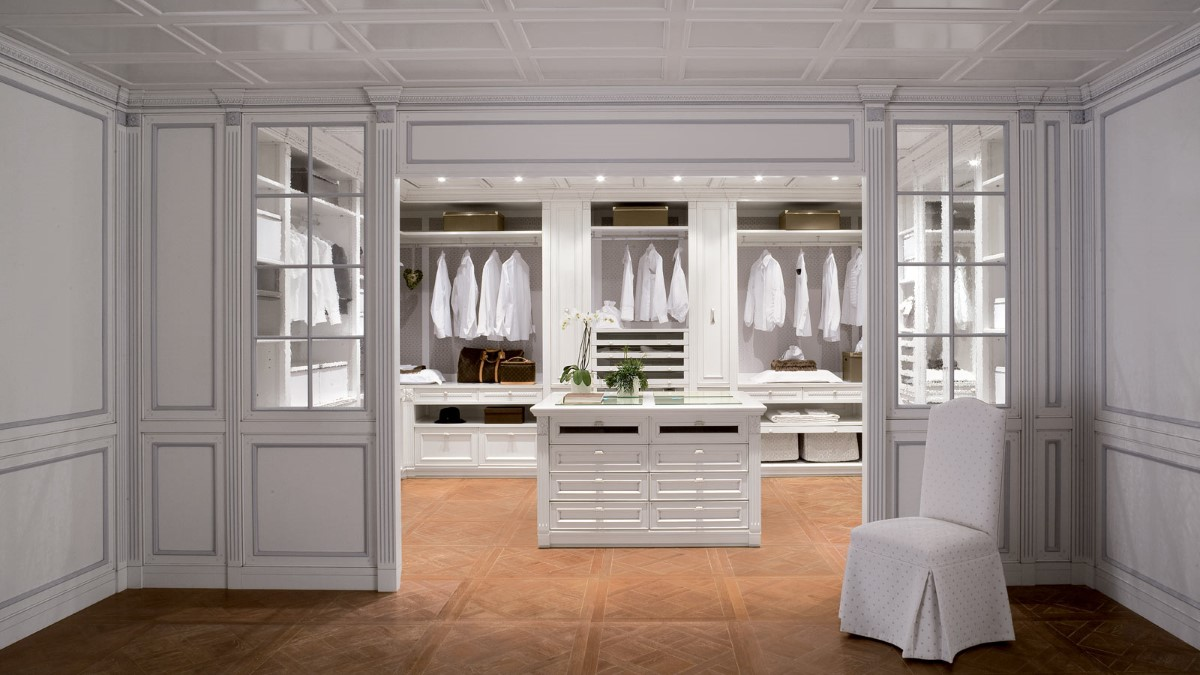 modern-white-walk-in-closet-organizer-design-with-creative-table-centrepiece-and-twin-chest-of-drawer